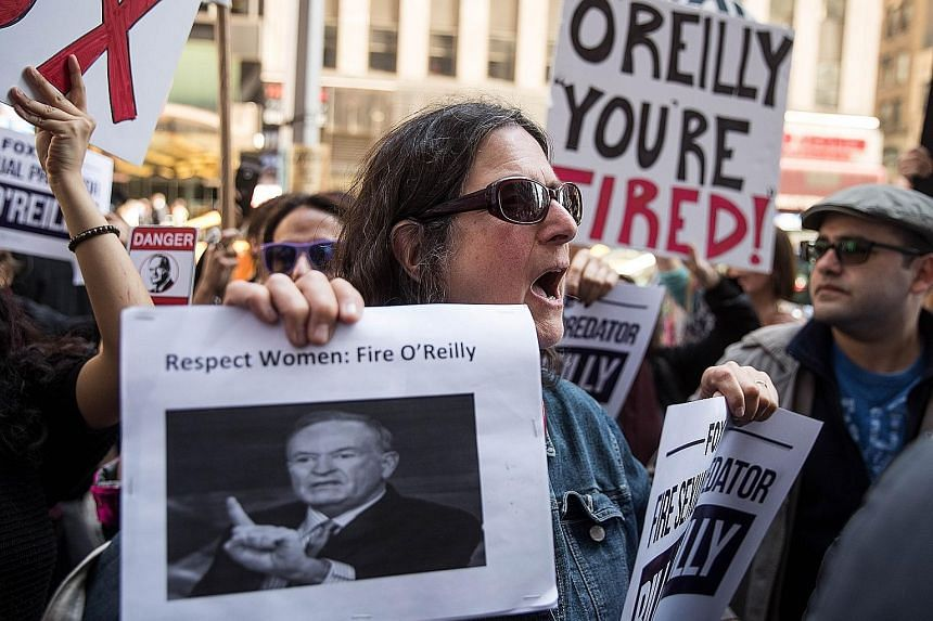 Protesters at a rally against top cable news anchor Bill O'Reilly outside Fox News' headquarters in Midtown Manhattan, New York City, on Tuesday.