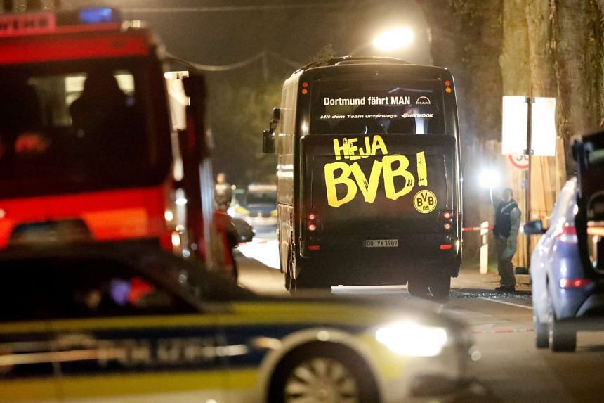 The team bus of German club Borussia Dortmund surrounded by police and emergency vehicles on a street after it was hit by three explosions in Dortmund, Germany on April 11, 2017