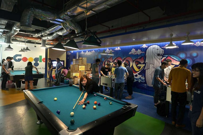 Google employees chill out at one of the many recreational spaces at Google's Singapore office.