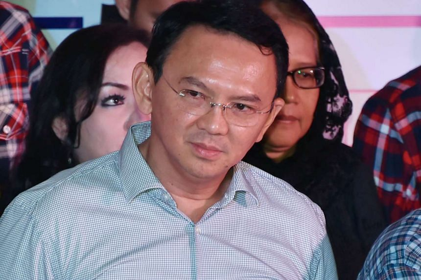 Jakarta's defeated incumbent governor Basuki Tjahaja Purnama (centre) looking on during a press conference in Jakarta, on April 19, 2017.
