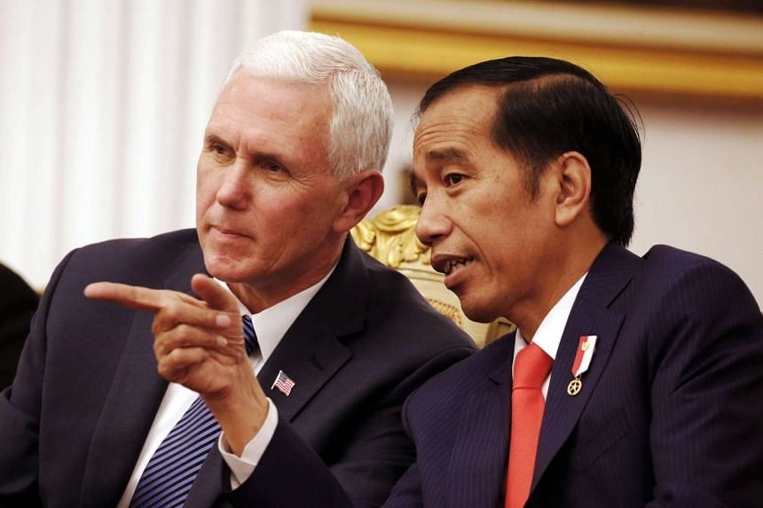 US Vice President Mike Pence (left) talking with Indonesian President Joko Widodo during their meeting at Merdeka Palace in Jakarta, Indonesia, on April 20, 2017.