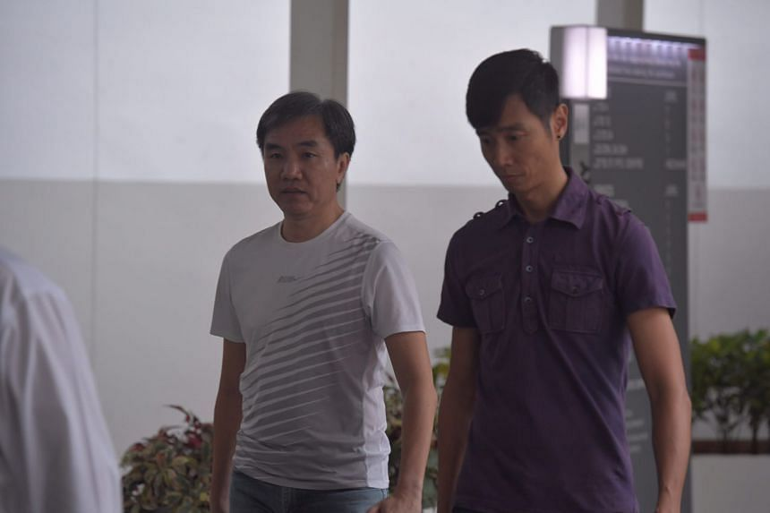 Former church finance committee member John Lam (left) arriving at court to serve his sentence of 1.5 years.