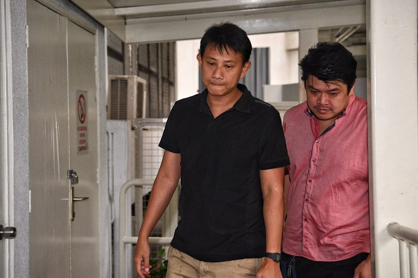 Deputy senior pastor Tan Ye Peng (left) arriving to start jail term of  three years and two months.