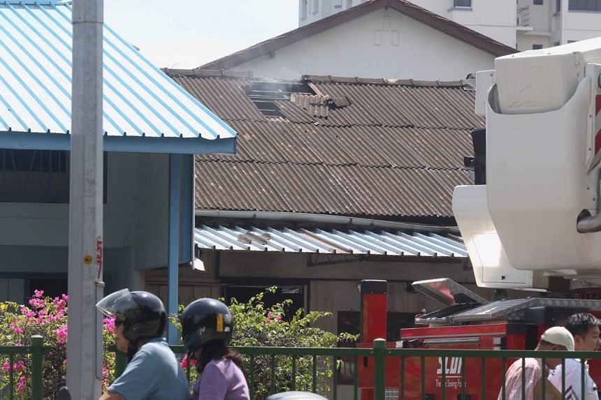 Firefighters broke the roof tiles of a terrace house while putting out a fire in the house along Punggol Road.