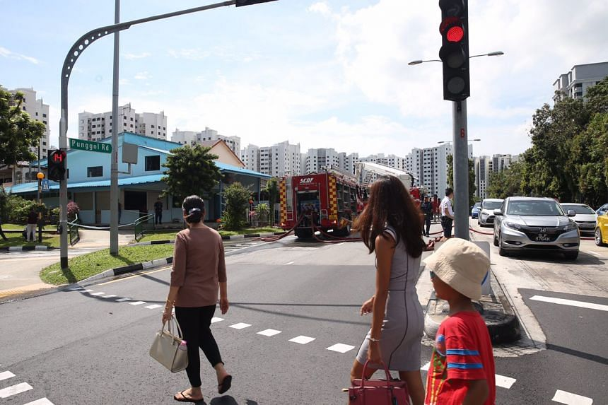 Fire engine at Punggol Road after a fire broke out at a house on April 21, 2017.