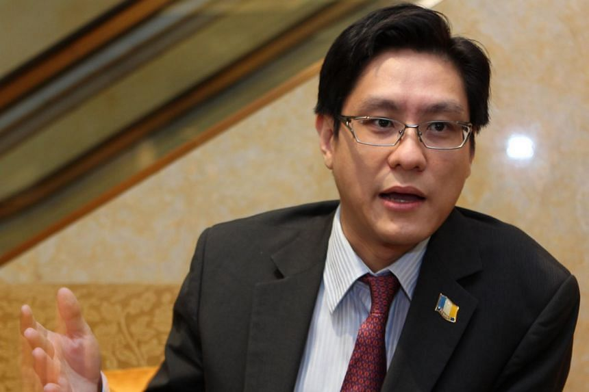 Malaysian MP Zairil Khir Johari, who is married with two children, has denied that the pictures were of him.