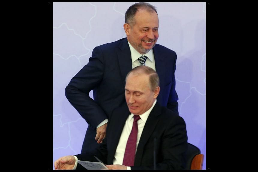 Russian President Vladimir Putin (front) and Russian steel tycoon Vladimir Lisin at a business event in Moscow on March 16, 2017.