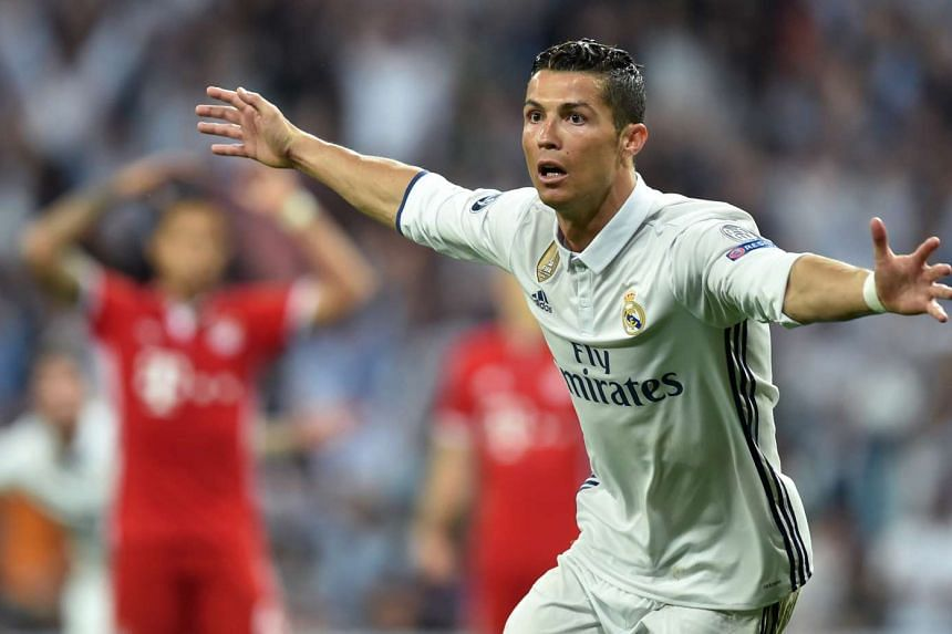 Real Madrid's Portuguese striker Cristiano Ronaldo celebrating after his second goal during the Uefa Champions League quarter-final second leg football match Real Madrid vs FC Bayern Munich, on April 18, 2017.