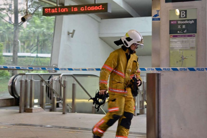 An SCDF fireman leaving the closed underground Woodleigh MRT station in Singapore on April 18, 2017.