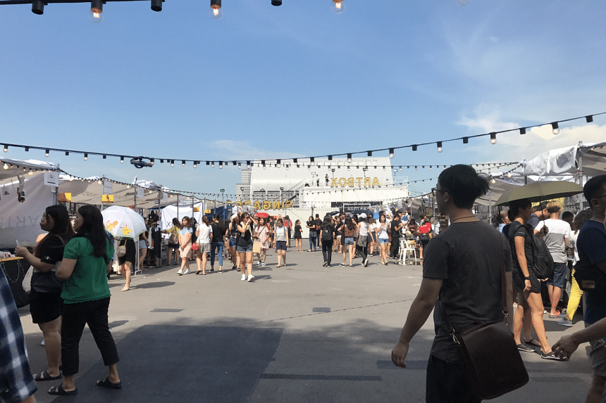 A photo taken on Friday (April 21) shows a significantly less-crowded Artbox Singapore. Crowd control measures introduced after last weekend's overcrowding include a wireless paging system, which will inform visitors when their food is ready, the rea
