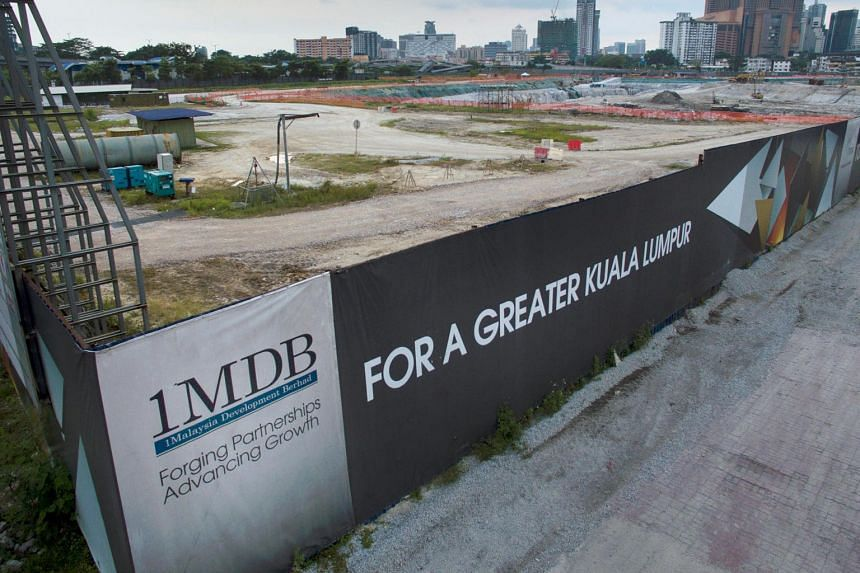 Signage for 1Malaysia Development Berhad at the Tun Razak Exchange project site in Kuala Lumpur. Bankers and legal executives believe the Malaysia-Abu Dhabi deal could significantly dilute the international legal challenges confronting the Najib admi