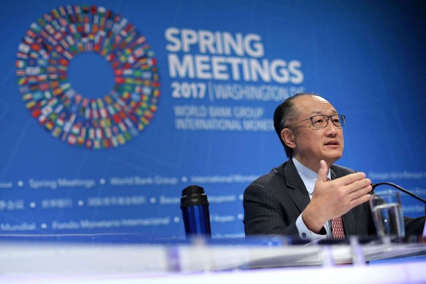 Caps: World Bank President Jim Yong Kim talking to reporters at a news conference during the World Bank and International Monetary Fund Spring Meetings, on April 20, 2017, in Washington, DC.