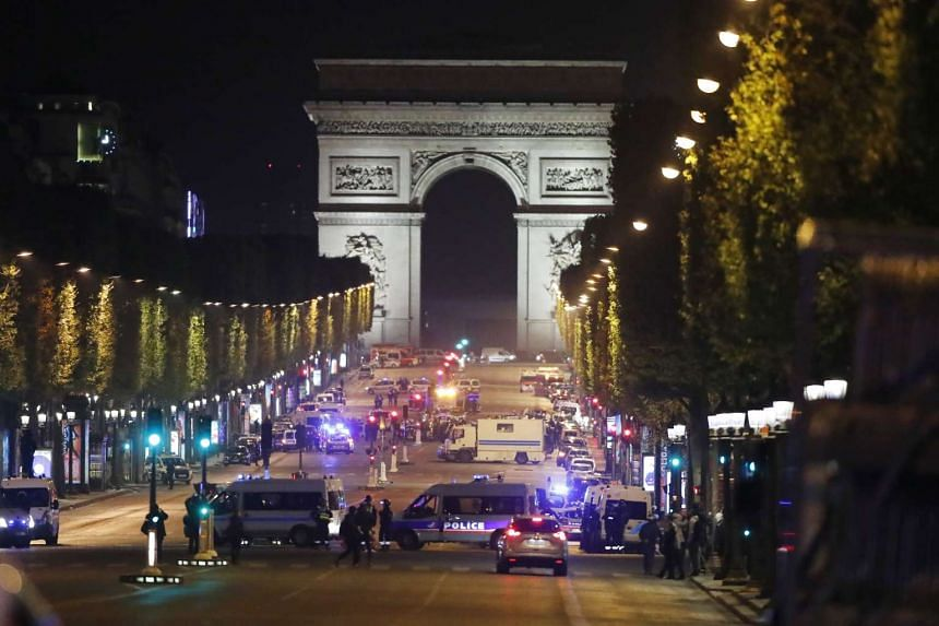 In an attack claimed by so-called Islamic State, a gunman shot dead a policeman on Champs Elysees Avenue, wounding two other officers before being killed by security forces.
