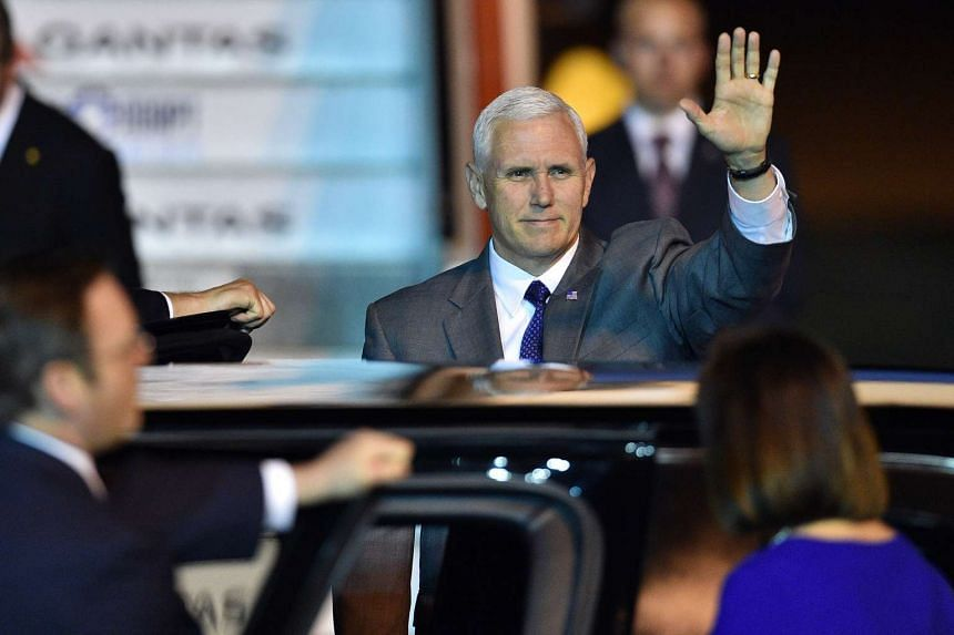 US Vice-President Mike Pence waves as he leaves the airport following his arrival in Sydney on April 21, 2017.
