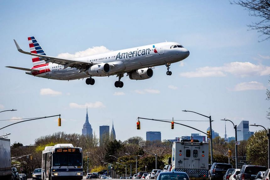 An American Airlines employee has been suspended after hitting a woman with a stroller.