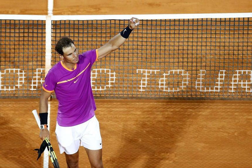 Spain's Nadal celebrates winning against Diego Schwartzman of Argentina.