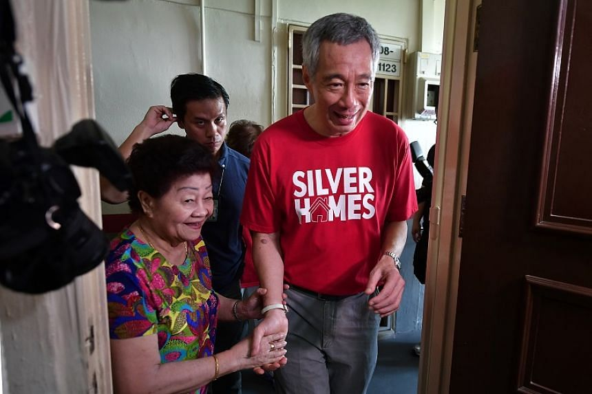 Prime Minister Lee Hsien Loong with Mdm Chen Yueh Lun at the launch of The Silver Alliance will kick off with the Silver Homes @ Teck Ghee exercise on Saturday (April 22), involving 100 student volunteers from Raffles Institution, Teck Ghee Primary S