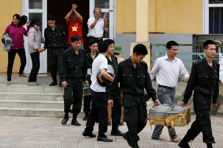 Hostages - who were held by villagers in a land dispute- walk out after being released in Dong Tam, outside Hanoi, Vietnam on April 22, 2017.