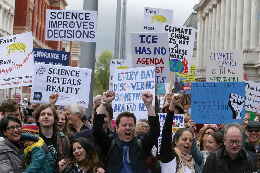 Scientists and science enthusiasts gather prior to the start of the 'March for Science' which celebrates the scientific method, outside the Science Museum in central London on Earth Day, April 22, 2017.