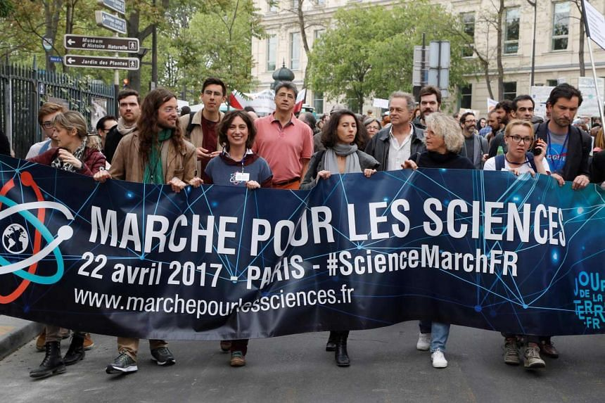 People take part in the March for Sciences as part of Earth Day 2017 in Paris on April 22, 2017.