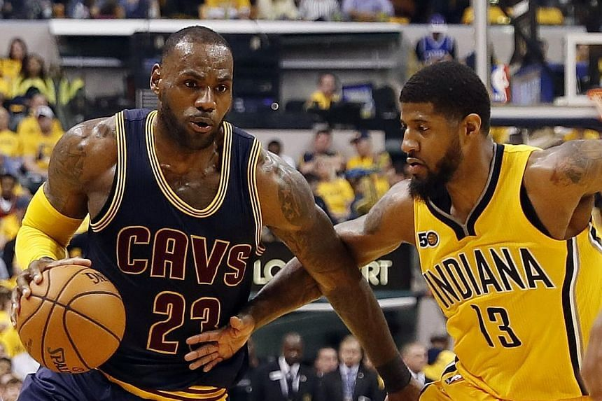 LeBron James (left) goes up against Indiana Pacers forward Paul George.