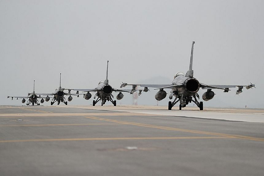 US Air Force F-16 Fighting Falcon fighter jets taking part in a bilateral training exercise at the Kunsan Air Base in South Korea on Thursday. US and South Korean officials have been saying for weeks that Pyongyang could soon stage another nuclear te