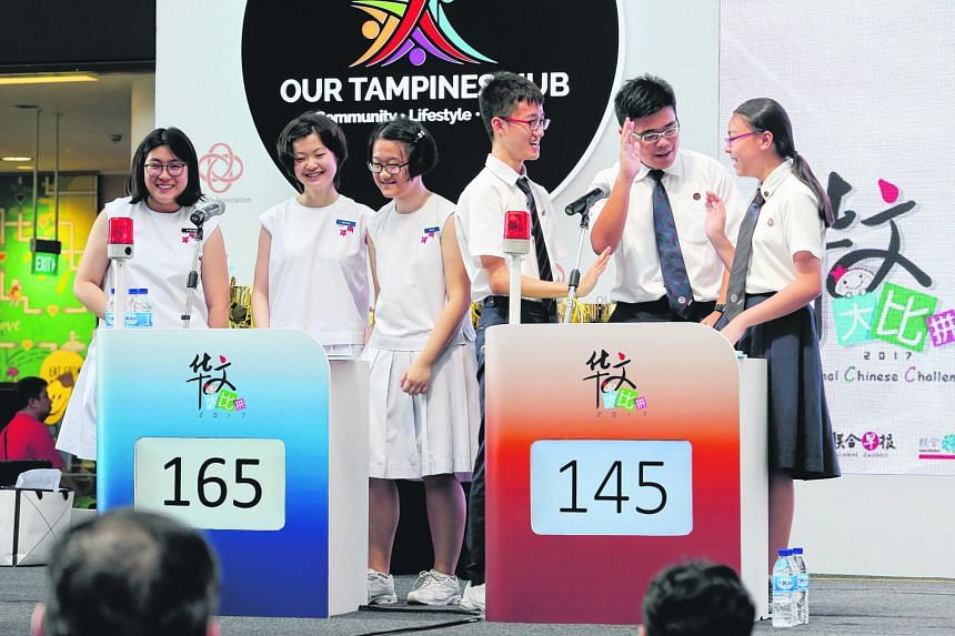 The Nanyang Girls' High team, consisting of (from left) Lim Tse Hwee, Yan Bin Bin and Chen Nan, won the secondary school category of the challenge for the third consecutive year, beating Dunman High's (from left) Hiew Min Zong, Shu Tian Yi and Neo Hu