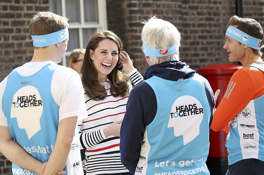 The Duchess of Cambridge speaking with runners at Kensington Palace before the Virgin Money London Marathon. Catherine, who has a chirpy public image, admitted on Thursday that motherhood can be isolating at times.