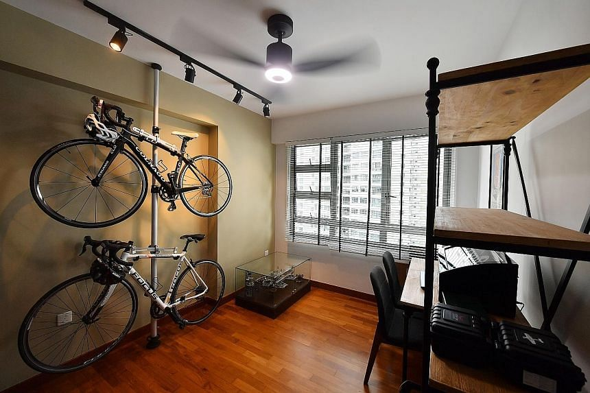 Bicycles are hoisted on a stand (above) in the study to maximise space and the master bedroom has a laidback vibe with its earthy palette.