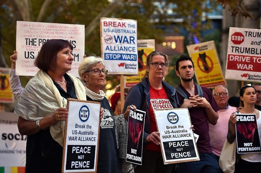 A rally against US Vice-President Mike Pence's visit in Sydney yesterday. Mr Pence's trip to the Asia-Pacific region is the first by a senior official in the Trump administration.