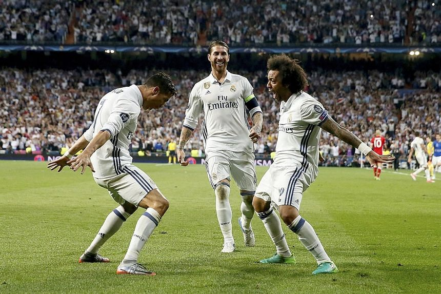 Real Madrid forward Cristiano Ronaldo (left), captain Sergio Ramos (centre) and defender Marcelo celebrate Ronaldo's third goal against Bayern Munich during their Champions League quarter-final second-leg match at the Bernabeu. The Portuguese made it