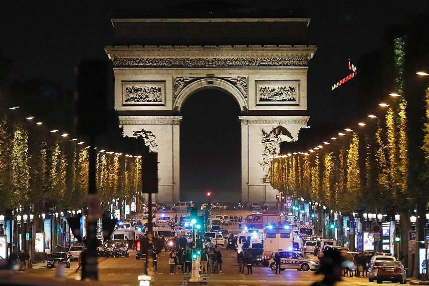 Dozens of emergency and security vehicles rushed to Paris' Champs Elysees on Thursday night after a gunman opened fire, killing a police officer and wounding two others. Security remains high in Paris after the shooting, ahead of the French president