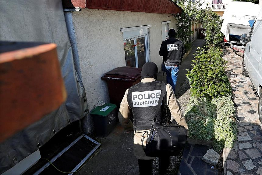 French police officers arriving at the home of the gunman in the eastern Paris suburb of Chelles. Three of his family members were taken into custody.