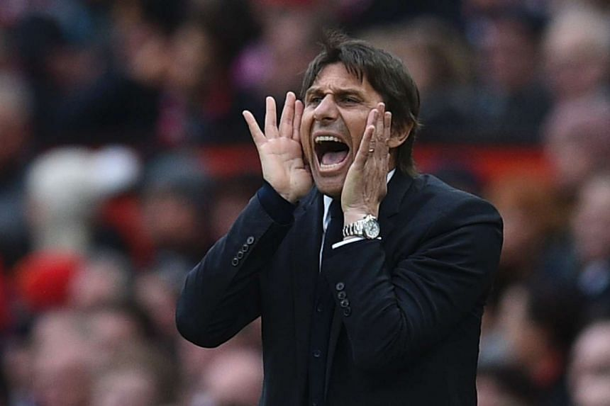 Chelsea's Italian head coach Antonio Conte shouts from the touchline during the English Premier League football match between Manchester United and Chelsea at Old Trafford in Manchester, north-west England, on April 16, 2017.