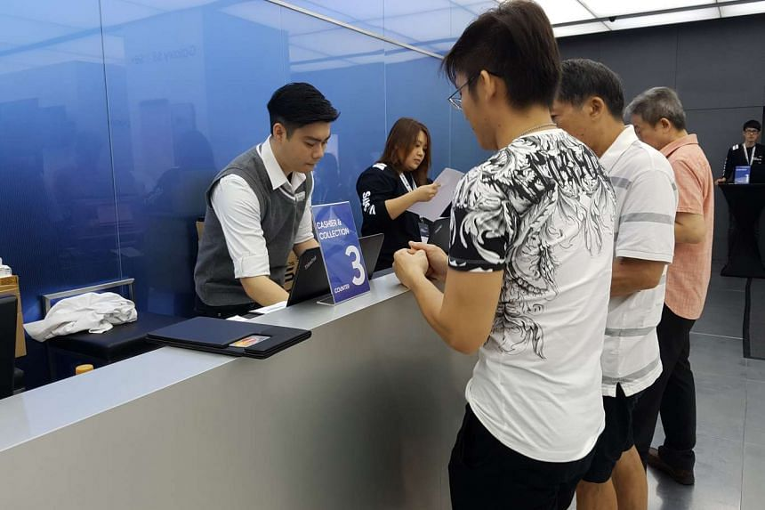 Customers collecting their Galaxy S8 and S8+ at the Samsung Experience Store at VivoCity.
