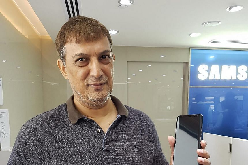 A customer with his Galaxy S8+ at the Samsung Experience Store at Paragon.