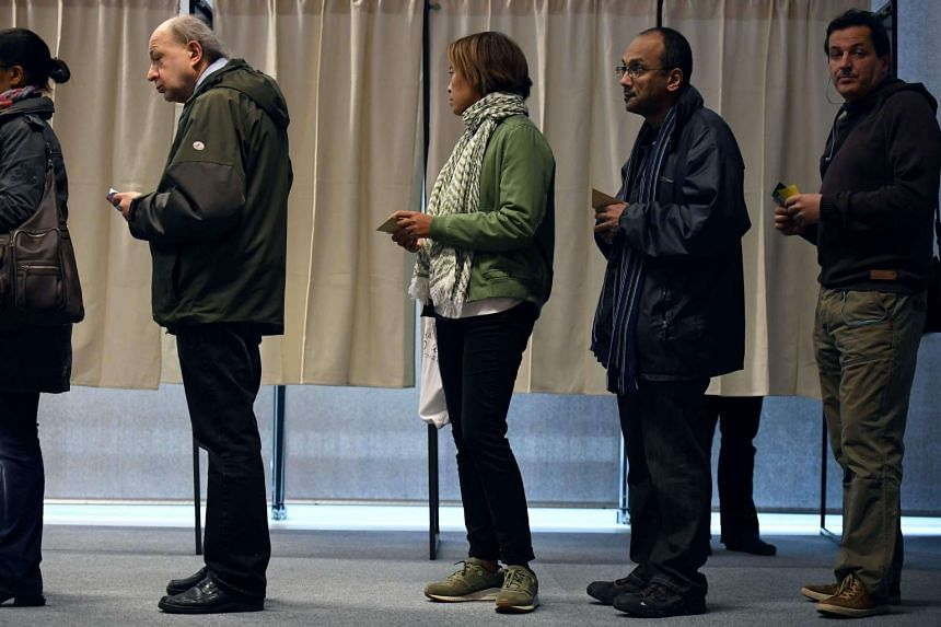 People queueing up to vote at a polling station in Rennes, western France, on April 23, 2017.
