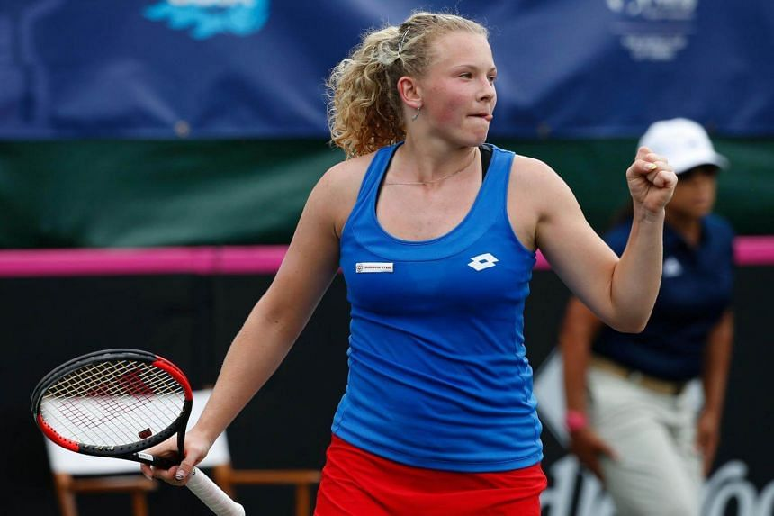 Katerina Siniakova reacts to winning a game against Shelby Rogers during their semi-finals Fed Cup match.