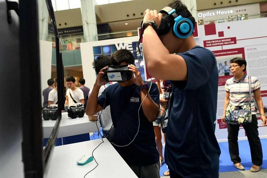 Visitors at the VR immersive zone at the Singapore Maritime Week exhibition at Marina Square.