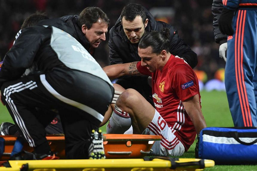 Manchester United's Swedish striker Zlatan Ibrahimovic gets treatment after injuring his knee on April 20, 2017.