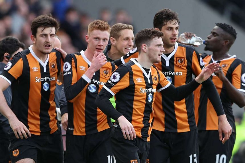 Hull City's Sam Clucas celebrates scoring their second goal with team mates.