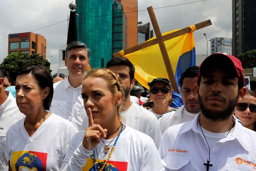 Lilian Tintori, wife of jailed opposition leader Leopoldo Lopez, gestures next to her mother-in-law Antonieta Mendoza (left), as they take part in the rally.