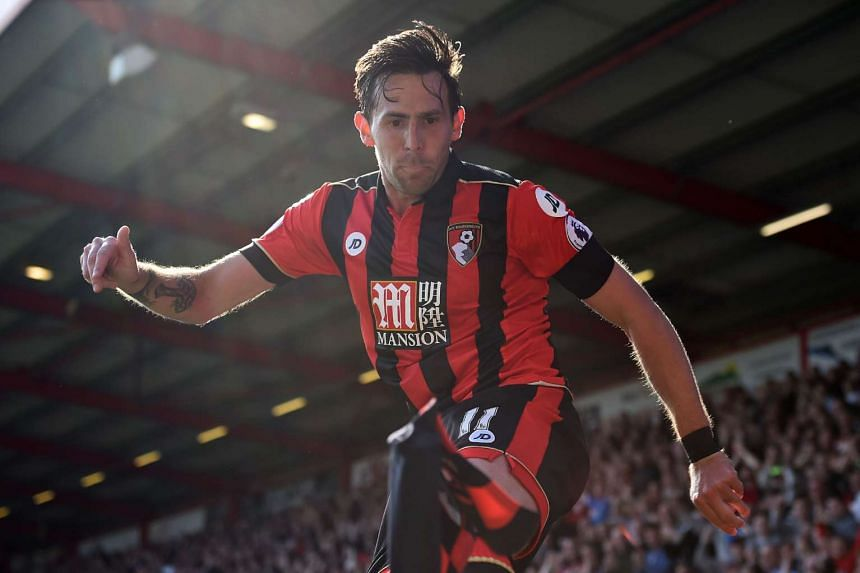 Bournemouth's English midfielder Charlie Daniels celebrates after scoring their fourth goal.