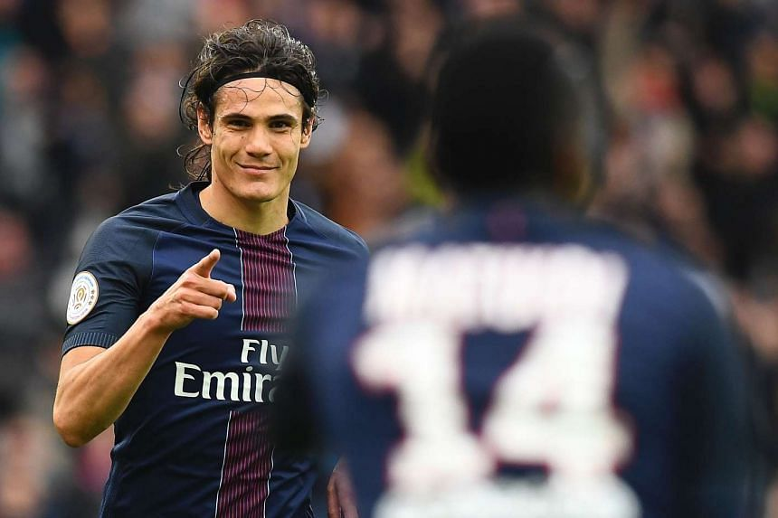 Paris Saint-Germain's Edinson Cavani celebrates his goal during the match against Montpellier.
