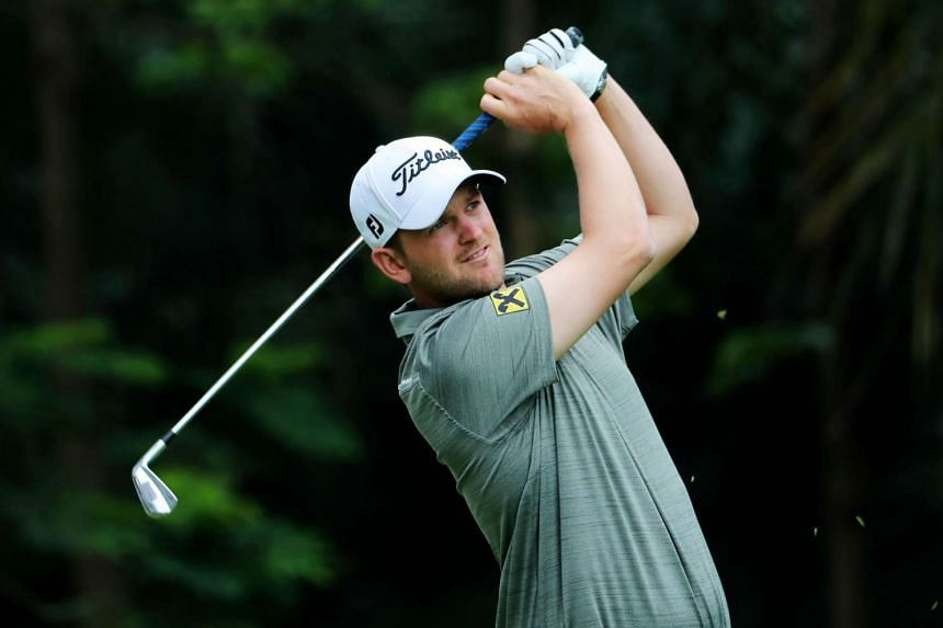 Bernd Wiesberger of Austria hits a shot during the third round of the Shenzhen International golf tournament in Shenzhen, in China's southern Guangdong province on April 22, 2017.