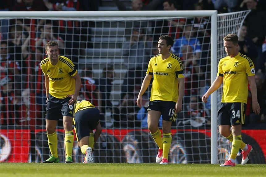 Middlesbrough's Ben Gibson and team mates looks dejected after Bournemouth's Charlie Daniels scored their fourth goal.
