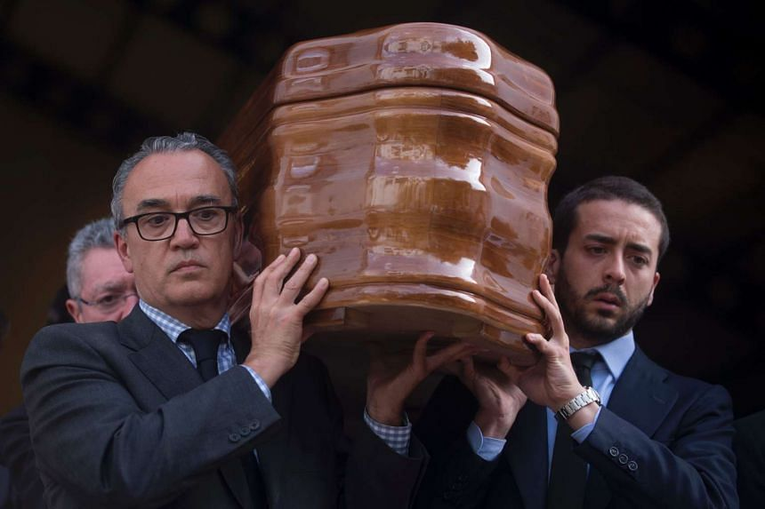 Relatives and friends of former Franco minister, Jose Urtrera Molina, carry his coffin during funerals in Nerja on April 22, 2017.