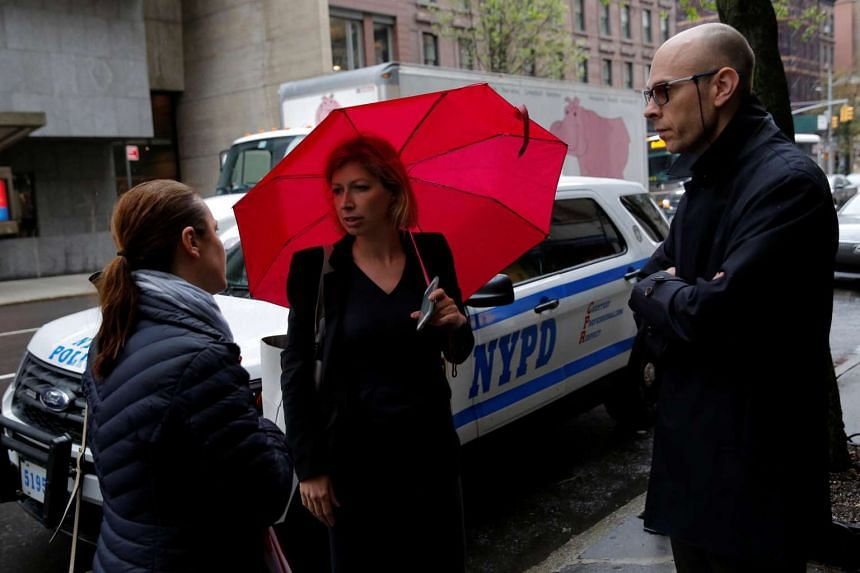 French Consul General Anne-Claire Legendre (centre) and Deputy Consul General Eric Bayer standing on Madison Avenue after being evacuated from the Consulate General of France in Manhattan, New York, United States, on April 22, 2017.