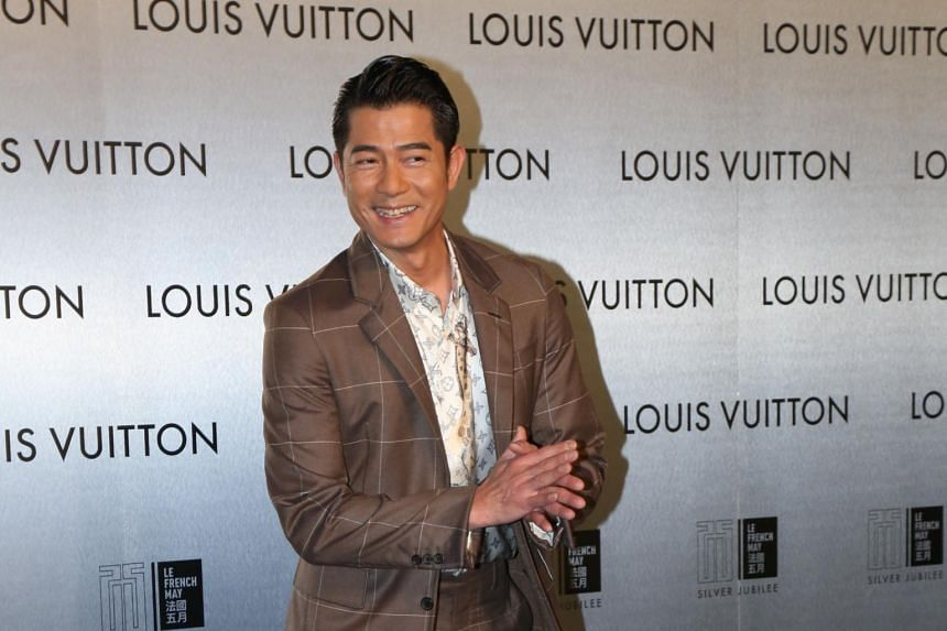 Hong Kong star Aaron Kwok was beaming and doing twirls for photographers at the Louis Vuitton event on April 21.