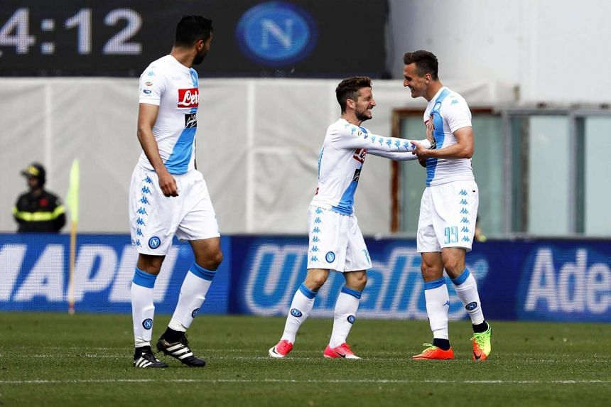 Napoli's Arkadiusz Milik (far right) celebrates with his teammates after scoring in the match against Sassuolo.